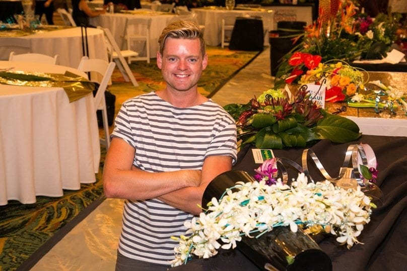 "Derek Woodruff, AIFD, PFCI, CF, owner of Floral Underground in Traverse City, Michigan, won the grand prize. He also placed first in ""Blue Suede Shoes"" and ""Hawaiian Wedding Song,"" and third in ""Crying in the Chapel."""