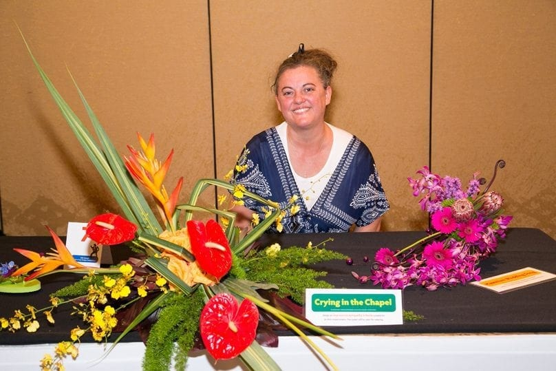 "Tricia Upshaw, AIFD, AMF, of Shirley's Flower Studio Inc., in Rogers, Arkansas and sponsored by the Mid America Design Competition, was second runner-up. She also placed third in ""Hawaiian Wedding Song."""