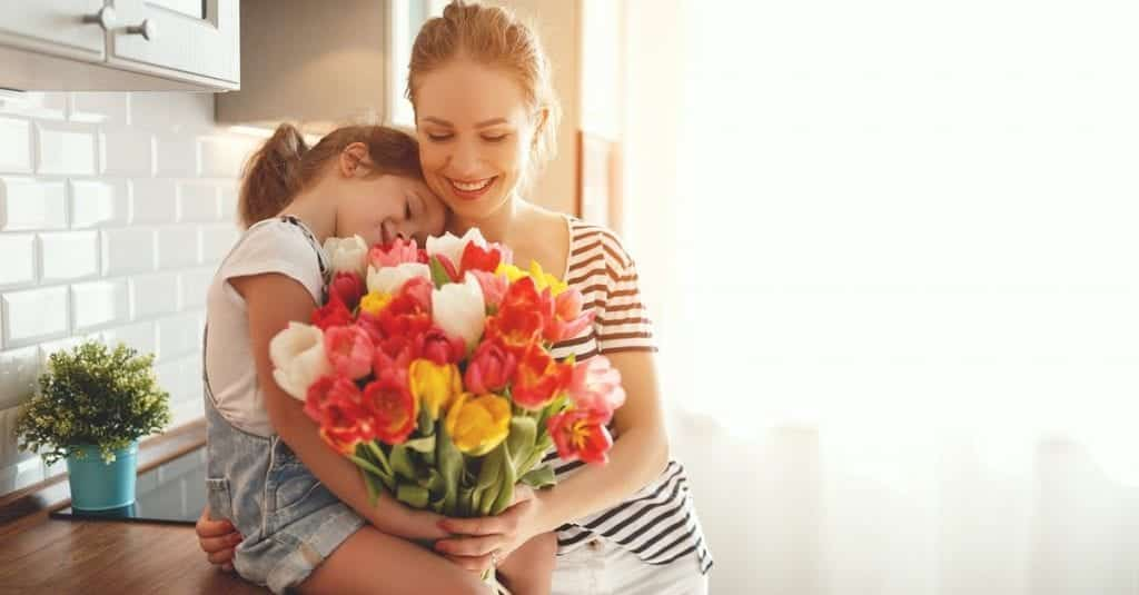 stock image of a mom receiving flowers