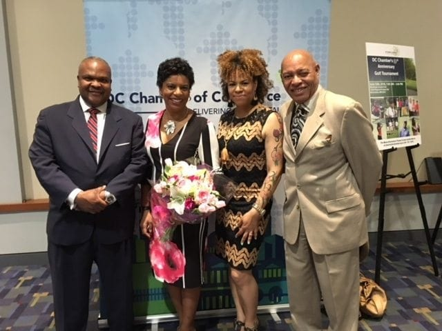 """A segment for """"Good Morning Washington"""" focused on Lee's Flower & Card Shop—the business' approach to Mother's Day and also its ties to the community and a recent award presented to co-owner Staci Lee Banks, second from left, who was named Small Businessperson of the Year by the D.C. Chamber of Commerce. Pictured with Lee: Her husband, Jeffrey Banks; sister and business partner Kristie Lee; and father Rick Lee."""