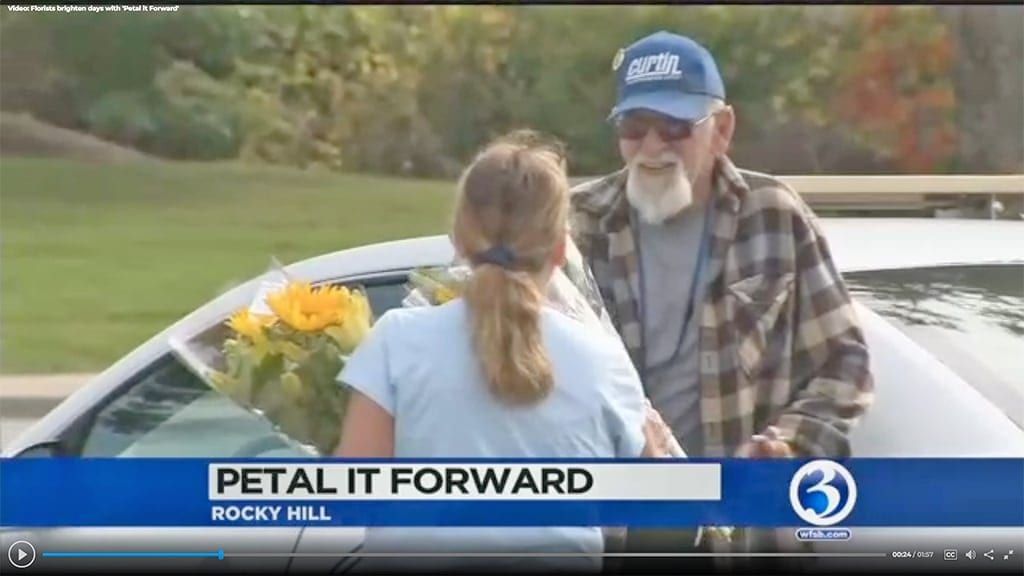"""Reporter Matthew Campbell tagged along in Rocky Hill, Connecticut, with retailer The Root System's """"surprise squad,"""" catching recipients' responses to Petal It Forward on camera."""