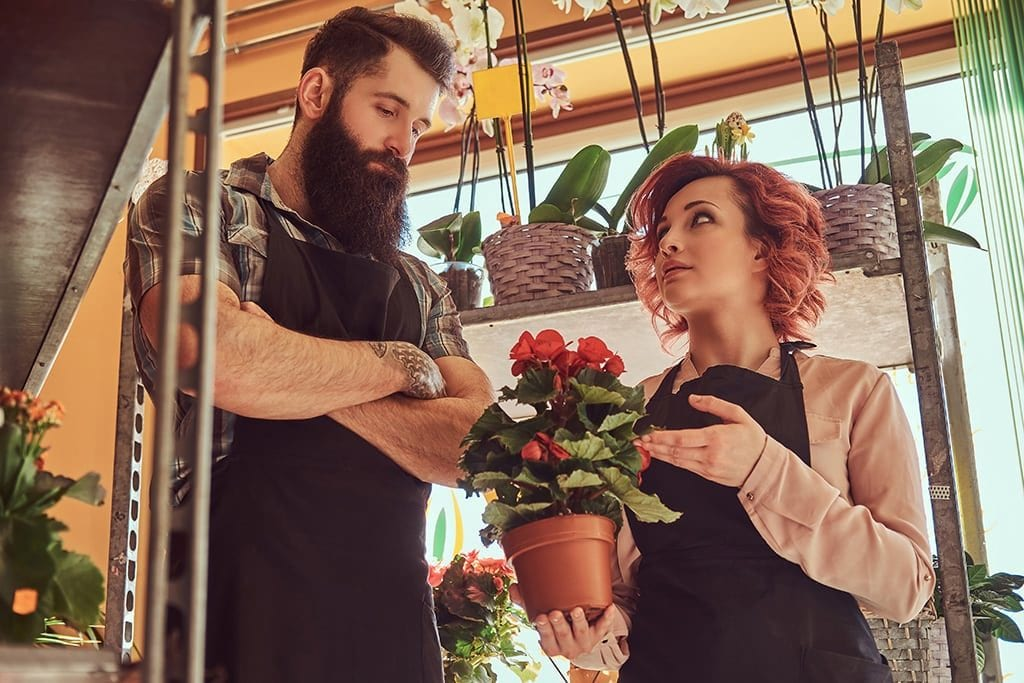 family members in a florist looking annoyed with each other
