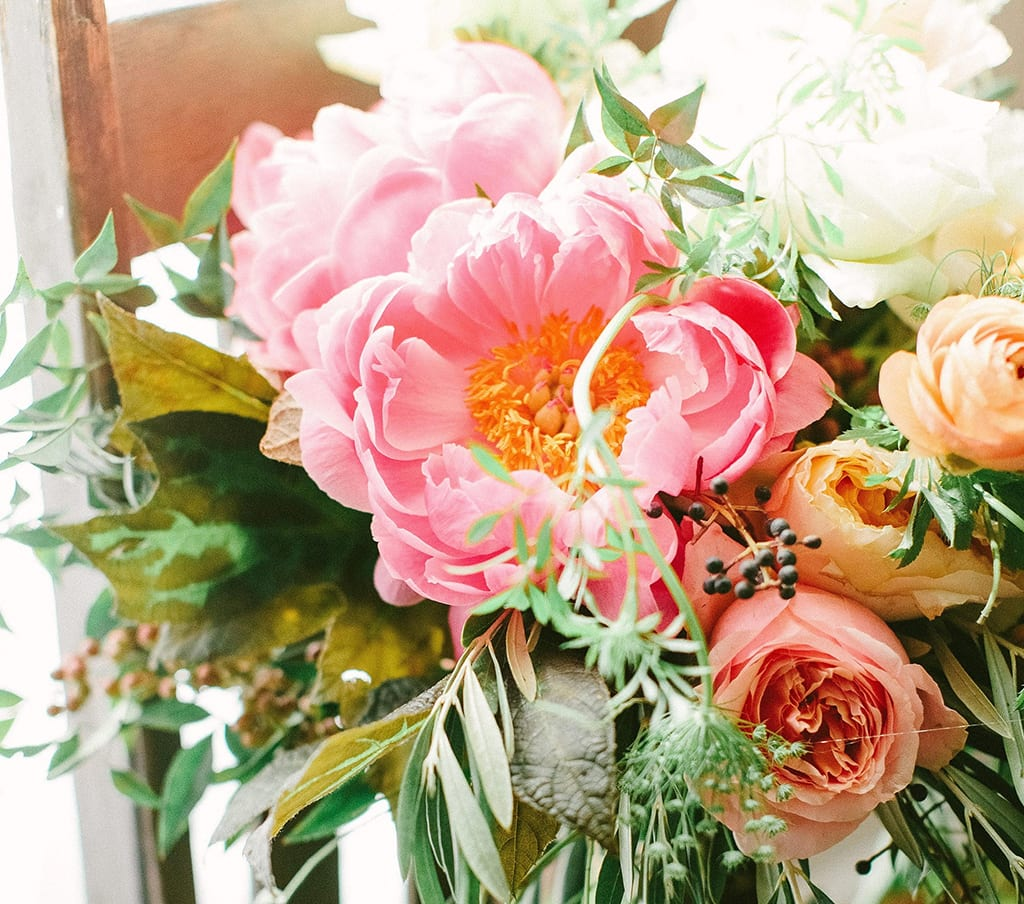 """""""Living Coral,"""" the 2019 Pantone Color of the Year, has many florist fans, including Georgia designer Christy Hulsey, who created this bouquet for a recent wedding. """"It's romantic, whimsical, traditional and mood-evoking,"""" she said. """"It fits in all the classic palettes yet provides just a hint of rock 'n roll."""" PHOTO BY HALEY SHEFFIELD."""