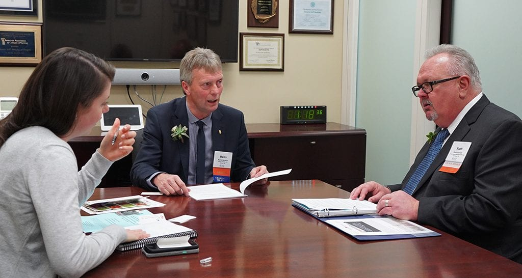 SAF Chairman Martin Meskers (center) of Orgeon Flowers in Aurora, Oregon, and Scott Isensee of Frank Adams Wholesale in Portland, meet in the office of Sen. Jeff Merkely (D-Oregon) during CAD.